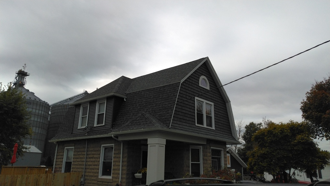 "New roof and gutters, IKO Cambridge shingles with ACM 5"" seam less gutters and 2x3 downspouts."