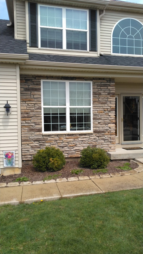 Cultured Stone facade around the front window.