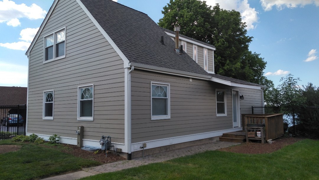 Remove existing siding, soffit, fascia and gutters. Supply and install Hardie board siding, LP soffit fascia and trim, 5-inch seamless ACM gutters with downspouts.