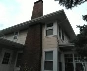 """Remove and replace windows with Vinylmax replacement windows.  Remove and replace the gutters with 5"""" gutters and 3x4"""" downspouts."""