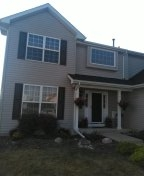 New Owens Corning Black Onyx shingles and Musket Brown Panel shutters
