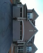 Siding architectural shingles. Aluminum garage and window wraps.