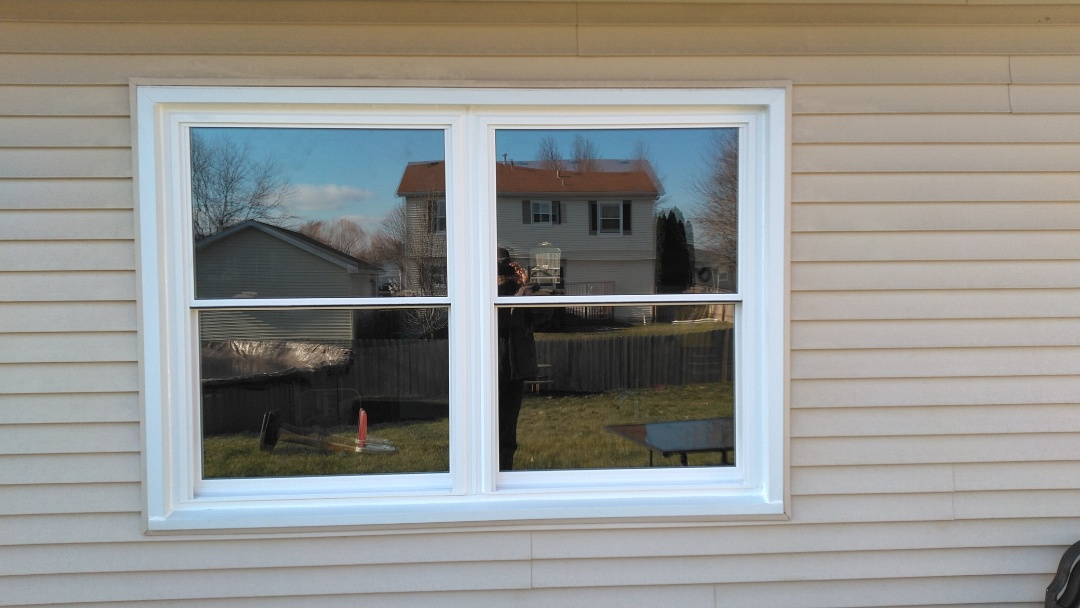New Midway Hawthorne windows, light oak inside, white outside with triple pane glass on the front of the home.