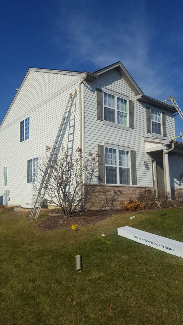 Minooka, IL - New gutters, downspouts and a wall of siding
