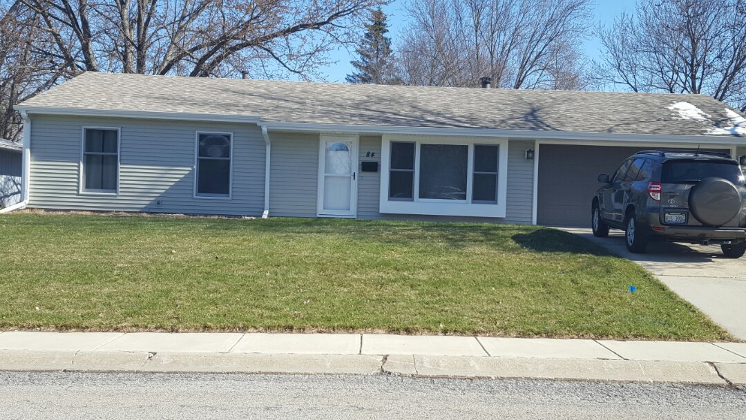 Montgomery, IL - Finished vinyl siding and gutters and downspouts