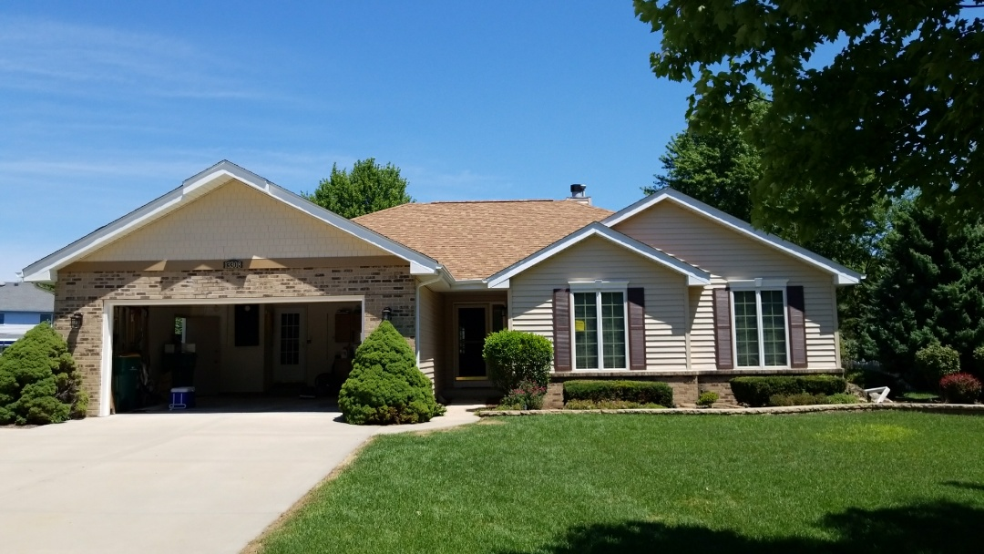 Plainfield, IL - New siding and window wraps And Masonary repairs