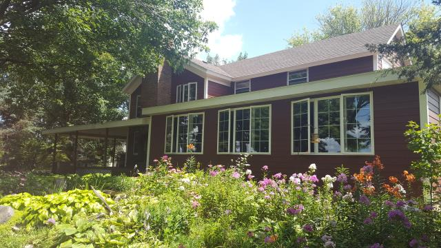 New Hardie siding, new IKO roof, and new Hawthorne windows.
