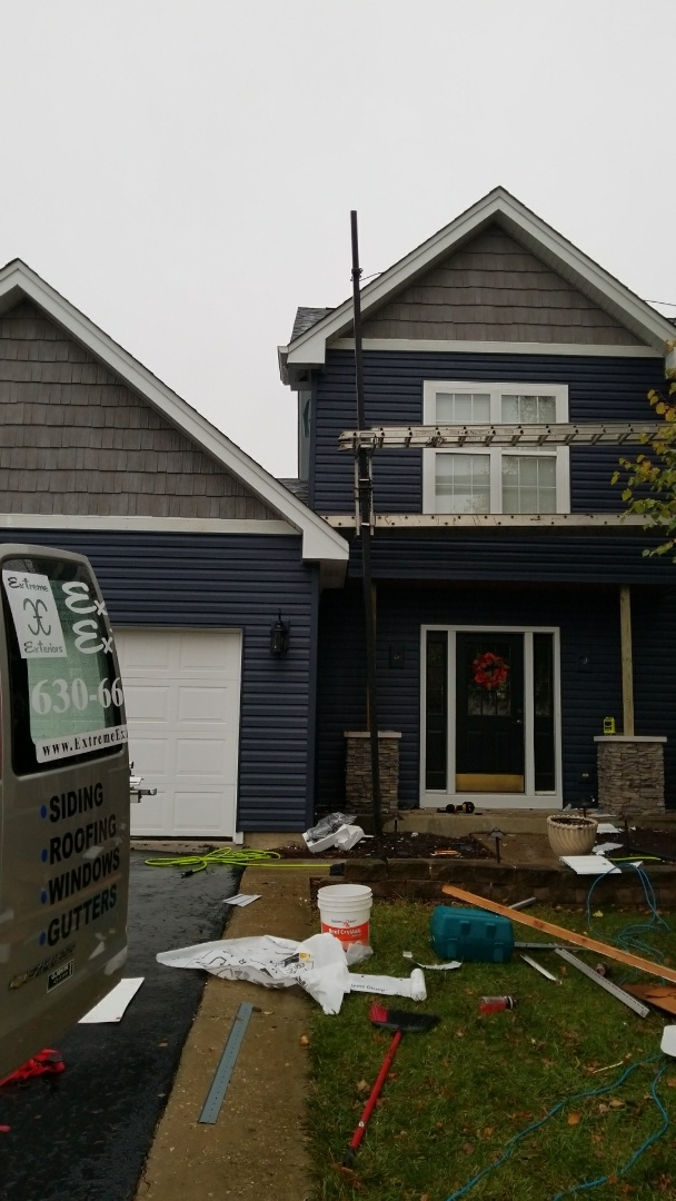 New vinyl siding and stone Porch  post