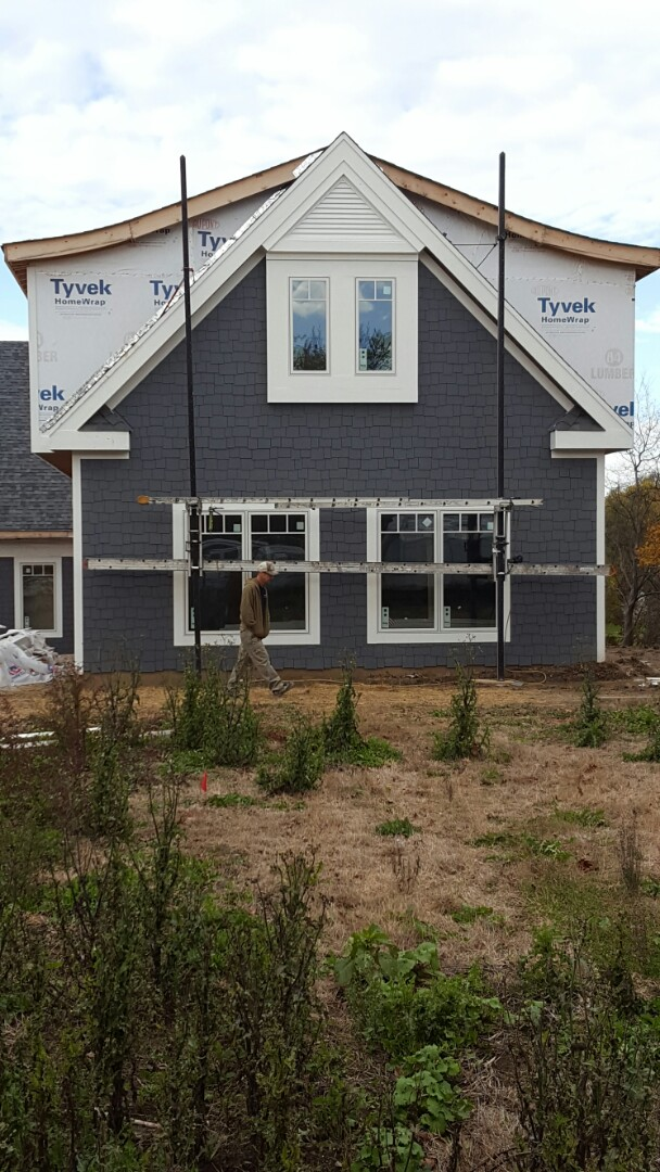 Hardie Board Siding, Bead Board Soffit, LP trim.