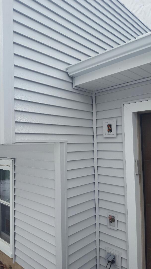 Mastic Quest vinyl siding, ACM aluminum soffit, fascia, Gutters amd downs, 2 Hawthorne new construction windows.