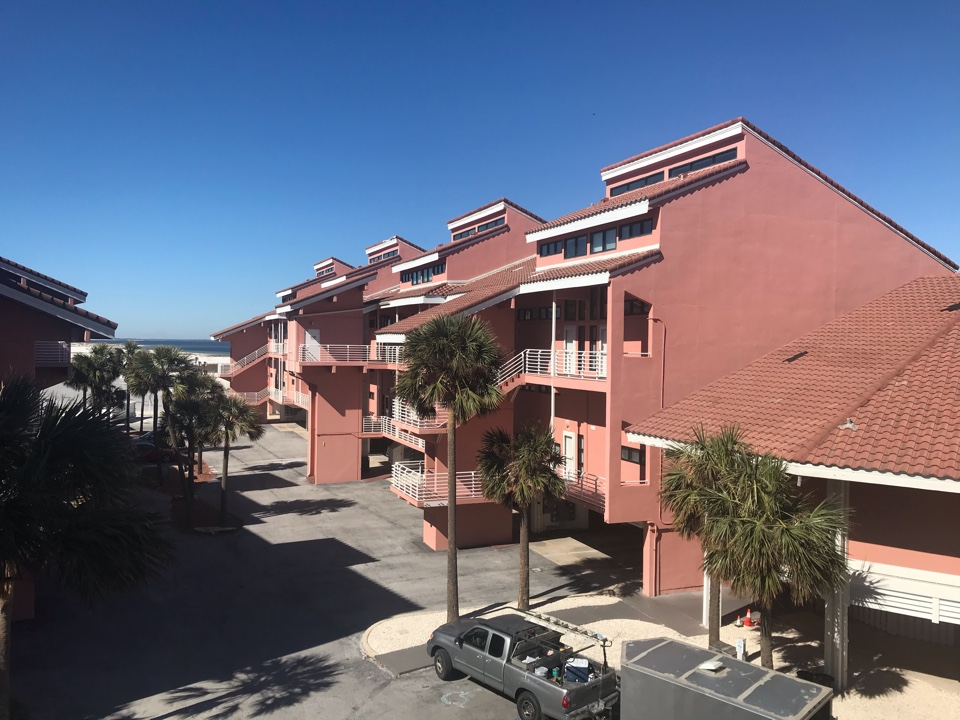 Condo in Pensacola Beach has affected hardwood floors due to hurricane Sally. Bedroom is 100% affected, living room is 30% affected. Recommend either replacing floors or attempt to dry using floor mat dehumidification and testing entire condo and HVAC with anti-microbial.