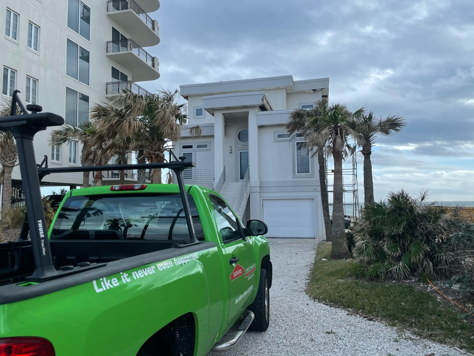 Vacation home in Perdido Key has major roof damage due to hurricane Sally, which allowed moisture intrusion on all south facing exterior walls. Home needs mold and water remediation.