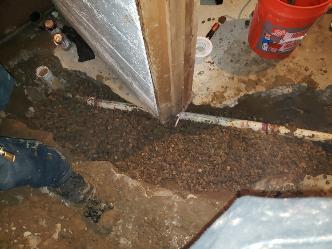 Install new sink line under basement floor