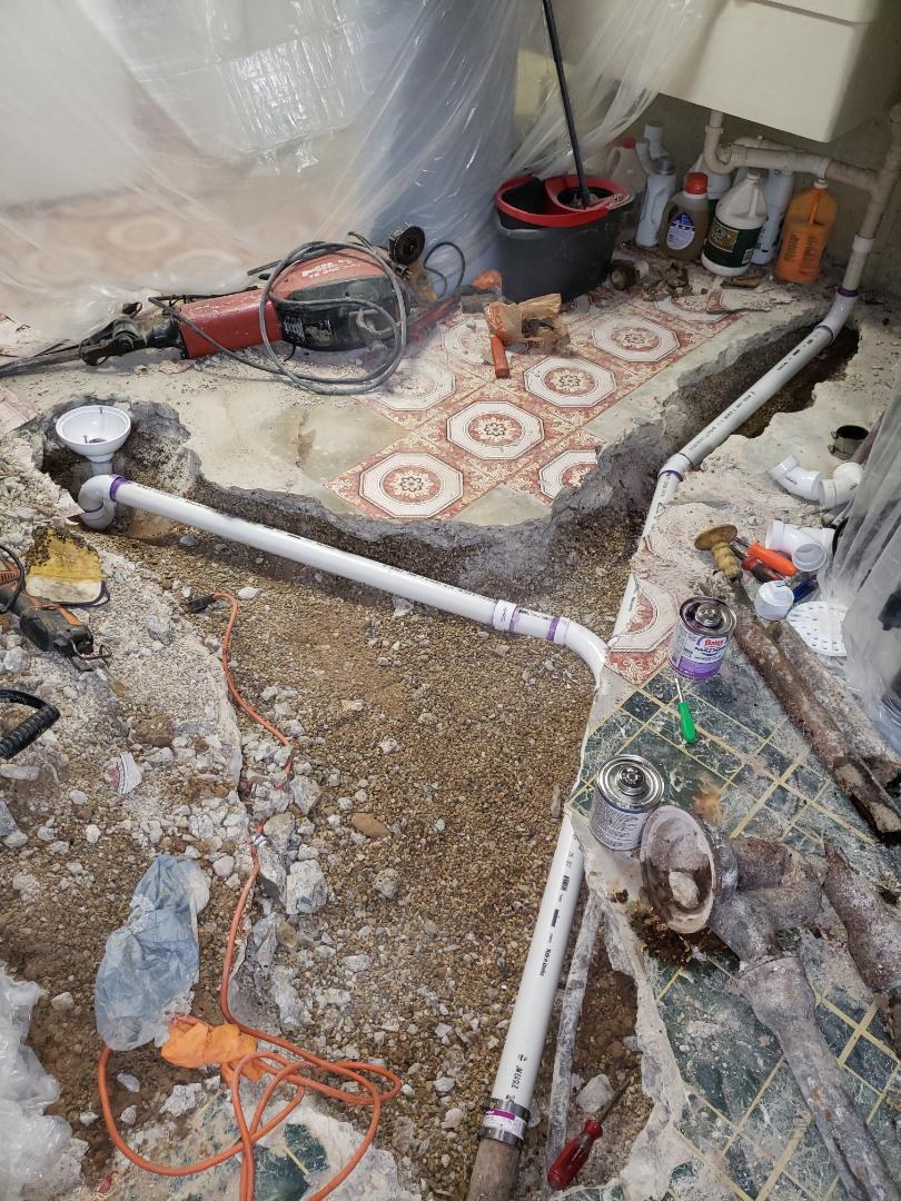Replace approx 20ft of kitchen sink line under concrete