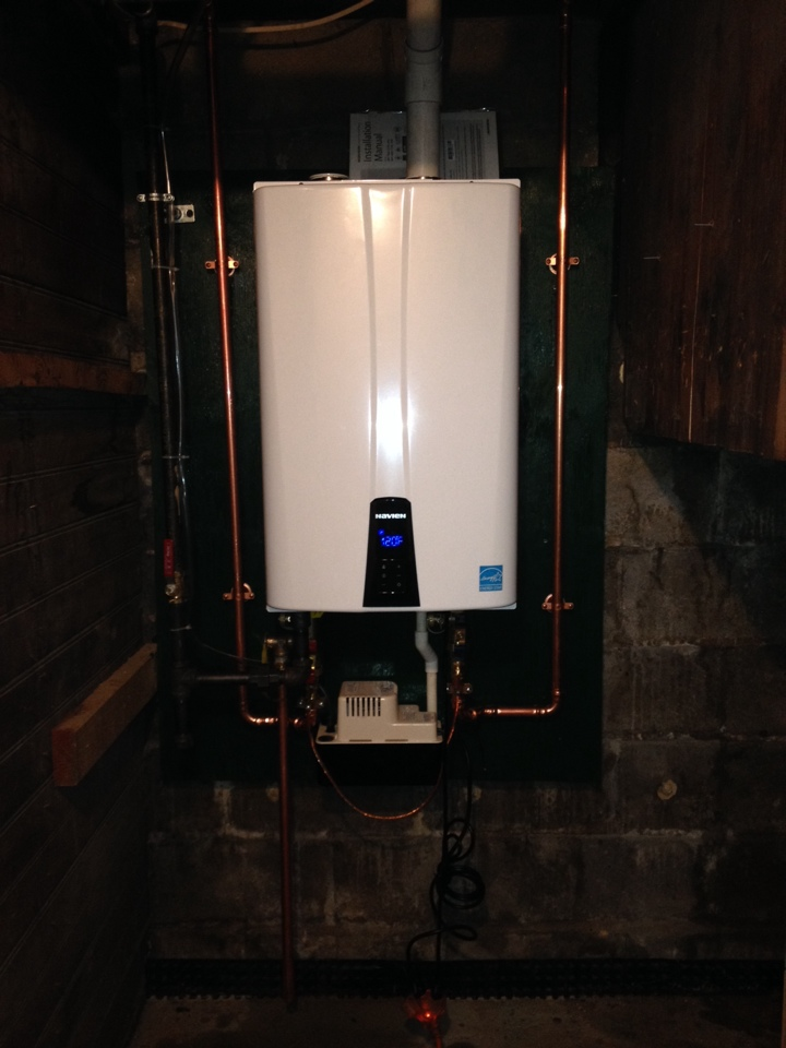 Here it is folks 1 day endless hot water isn't it beautiful. Navien tankless hwh. And look at the space you save gotta love that