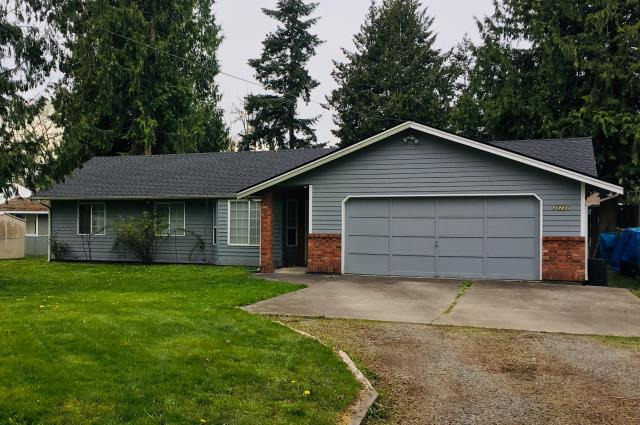 Auburn, WA - A complete tear off and a GAF Timberline HD composition shingle was installed, Charcoal. This roof now carries the System Plus Warranty on it.  A few sheets of decking were replaced and a new 18' barge board was installed.