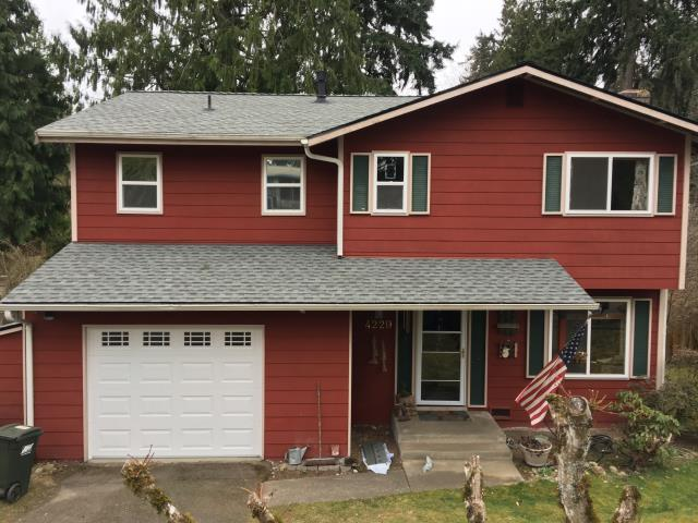 Auburn, WA - Complete tear-off of the existing roof A GAF Timberline High Definition shingle was installed, Charcoal Some decking was replaced and all the loose plywood was renailed to meet code This roof now has a Golden Pledge warranty on it!