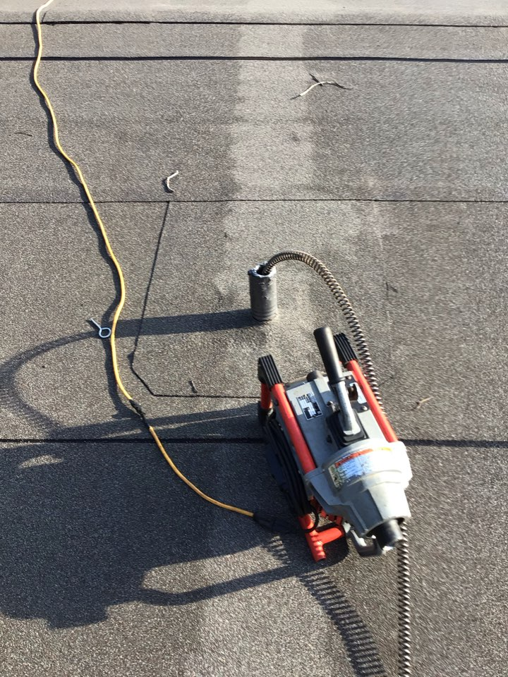 Sanford, FL - Client have laundry clogged, i running my drain cleaner machine from the roof vent drain.