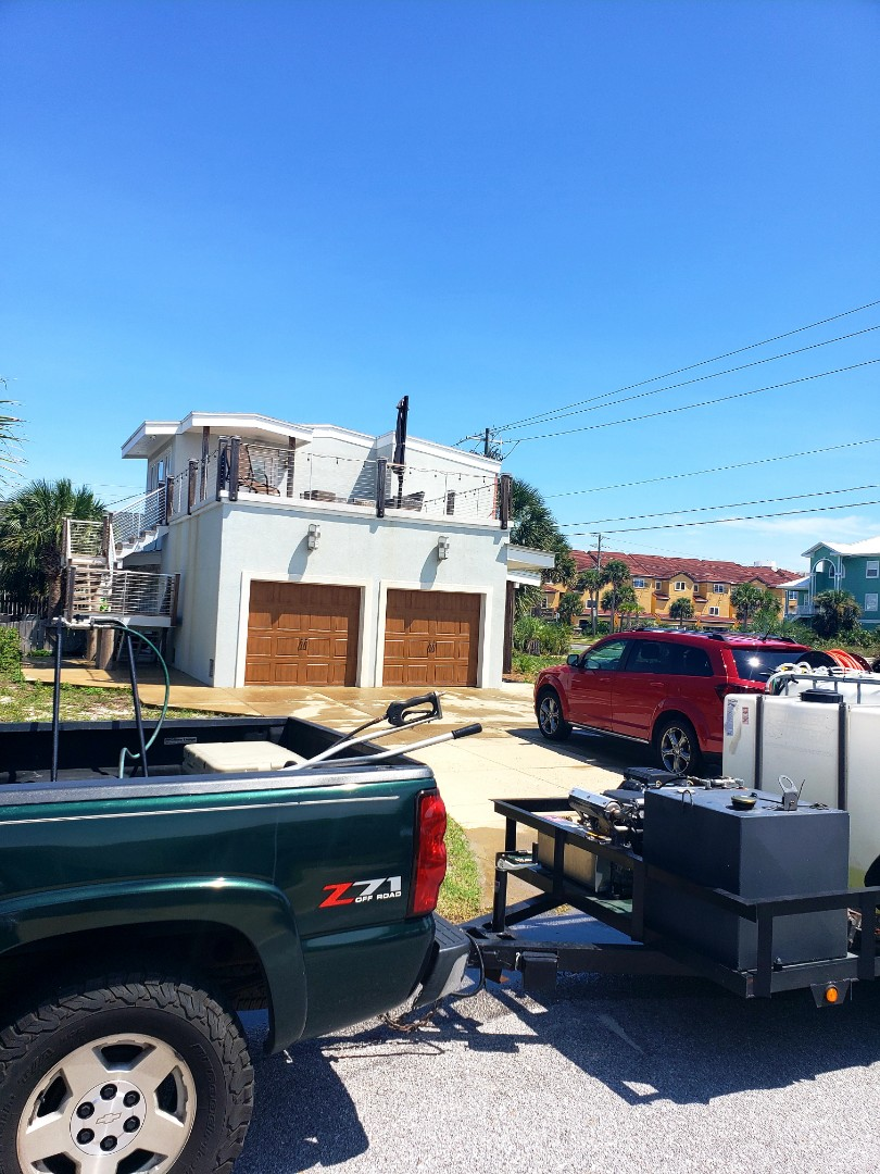 Gulf Breeze, FL - Pressure washing house & power washing concrete.