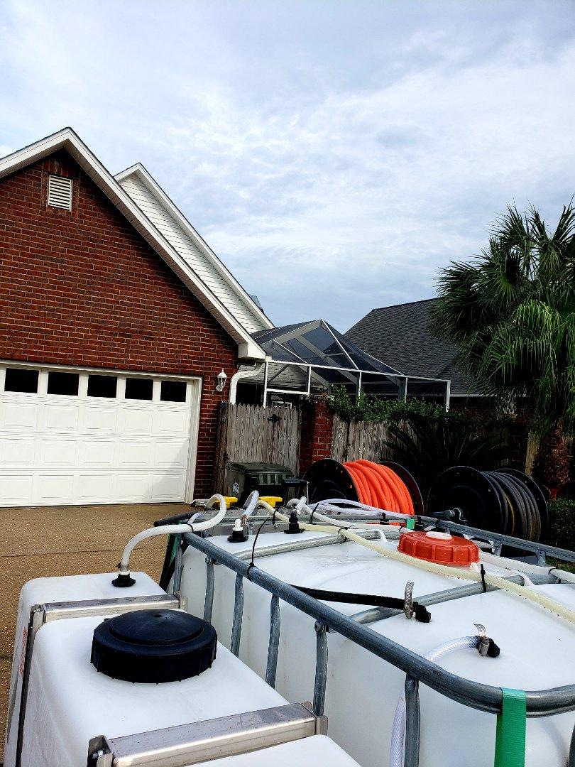 Power washing pool cage, pressure washing house & sidewalks