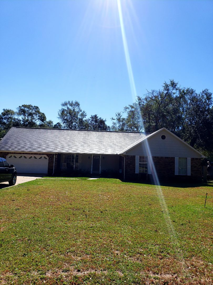 Pace, FL - Roof cleaning and pressure washing house.