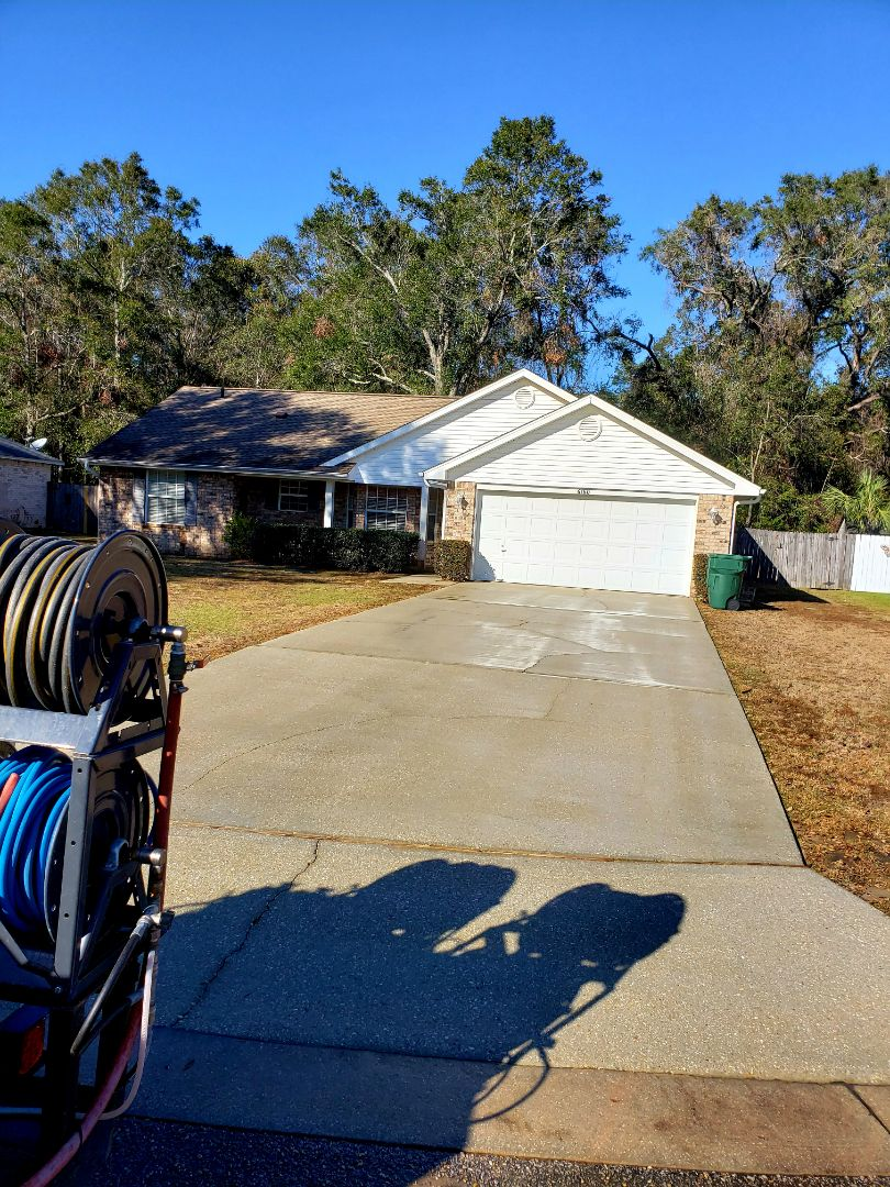 Pressure washing home and driveway