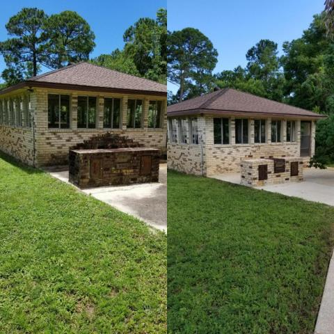 Beauchamp Power Washing is cleaning a house and driveway In the Bay Cliff neighborhood off Scenic Highway in Pensacola Florida.
