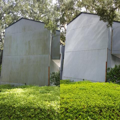 Power washing a house and cleaning concrete in Cantonment.
