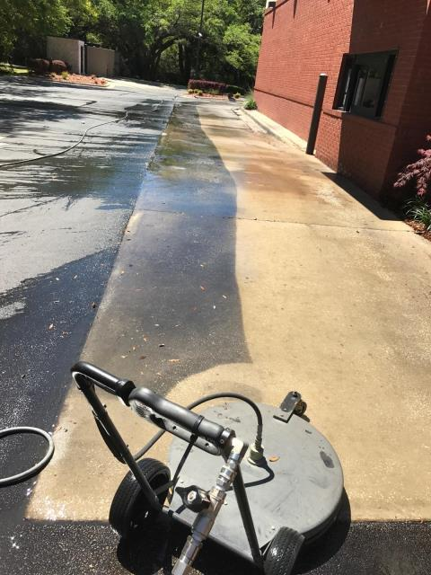 Pressure washing drive through and cleaning sidewalks.