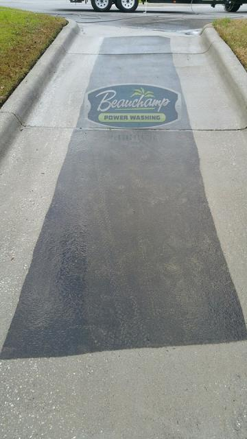Cleaned concrete driveway and sidewalk.