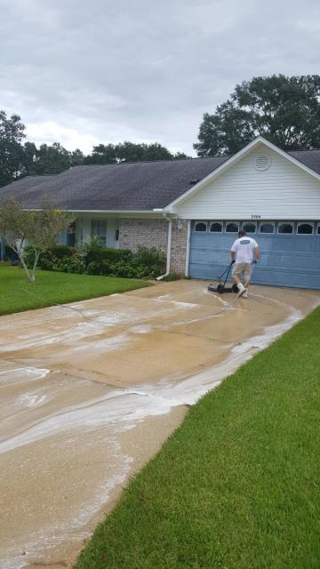 Cleaning a house and driveway in Cantonment Florida.