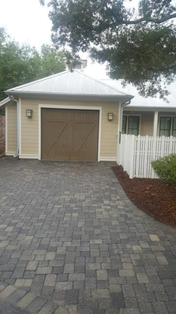 Roof cleaning and house washing in Gulf Breeze Proper Florida.