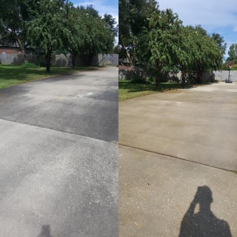 Pressure washing in Gulf breeze Florida cleaning a driveway & sidewalks.