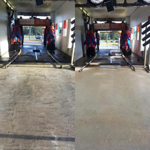 Pressure washing building, concrete & wash bays in Pensacola Florida.