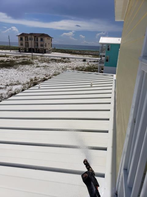 Roof & concrete cleaning on Navarre Beach.