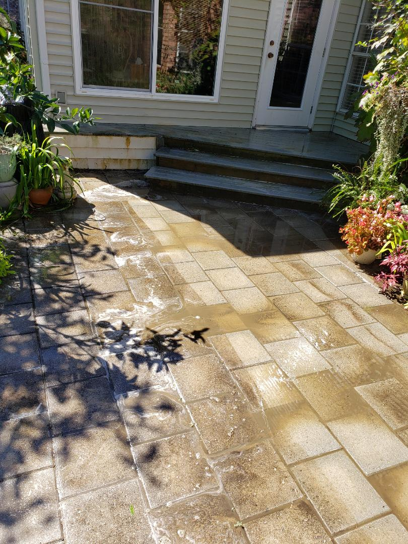 Pressure washing patios & driveway in Gulf Beeeze.
