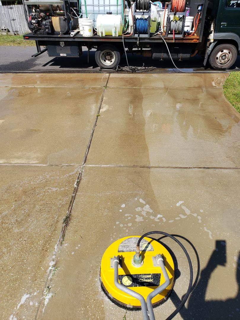 House washing & pressure washing concrete in Gulf Breeze.
