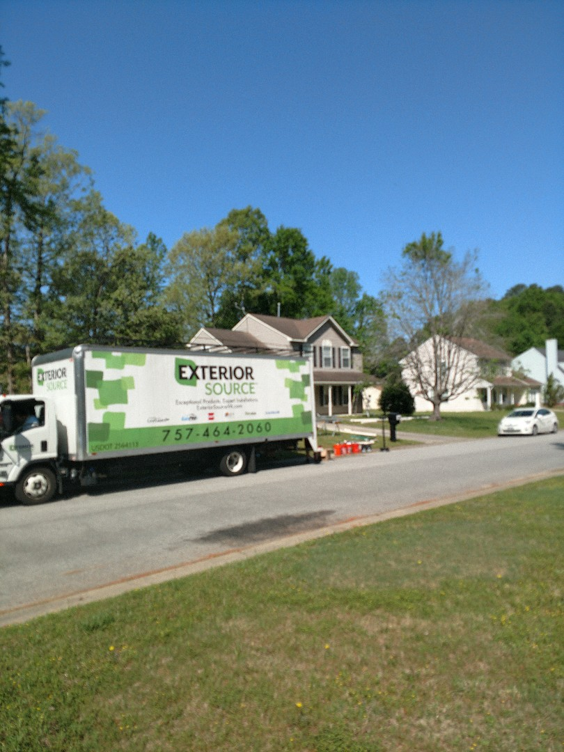 Suffolk, VA - We have a crew replacing old clogged open top gutters with our seamless one piece LeafGuard gutter system.
