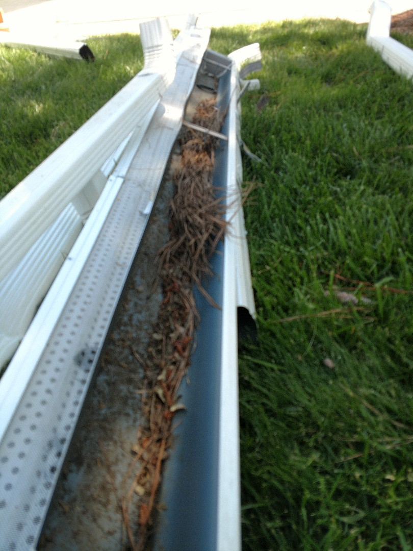 Virginia Beach, VA - In VA Beach today replacing 12,520 feet of old clogged gutters with our LeafGuard gutter system.