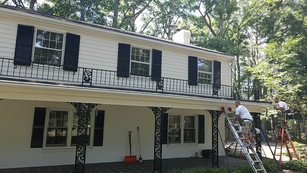 Richmond, VA - Leafguard gutters being installed on this New Orleans-style house