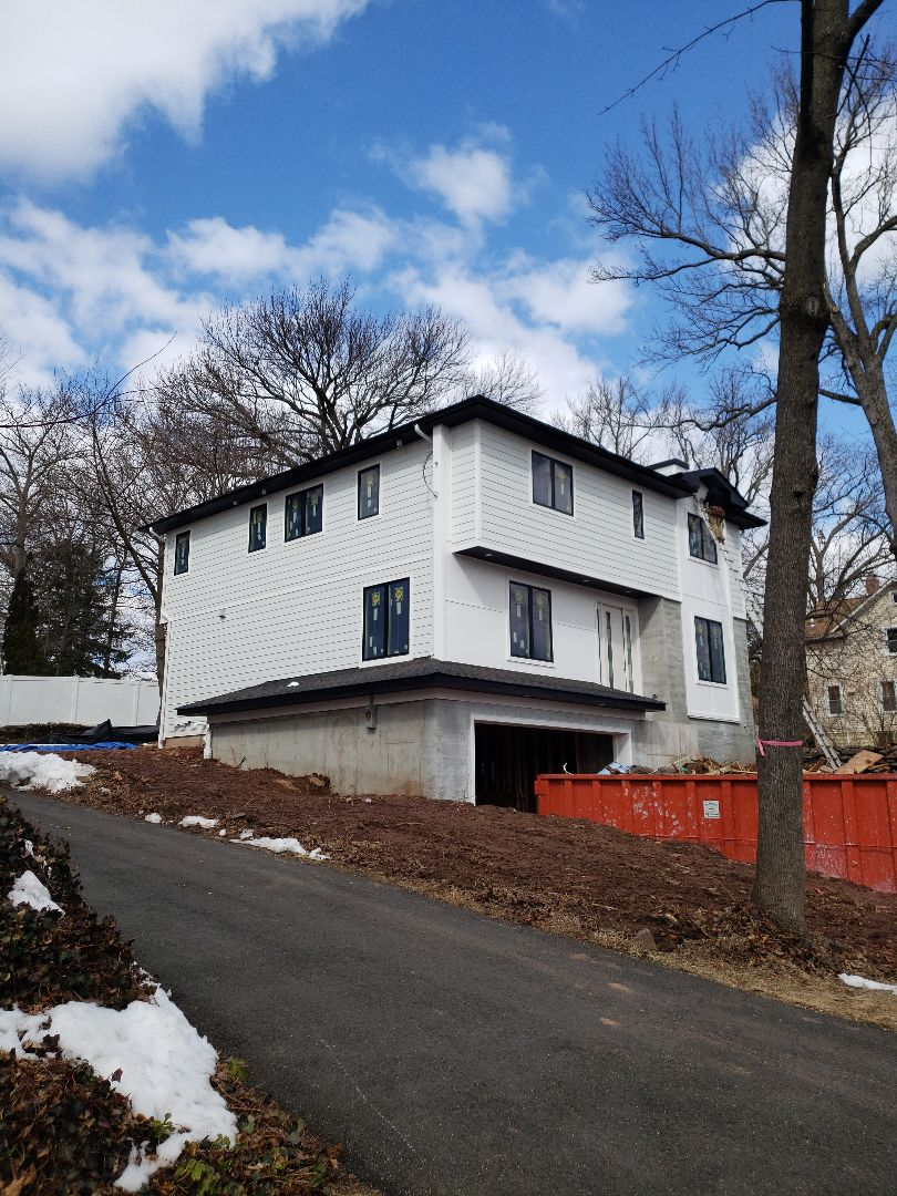 Cresskill, NJ - Installing New James Hardie Siding. Contemporary Look Black and white