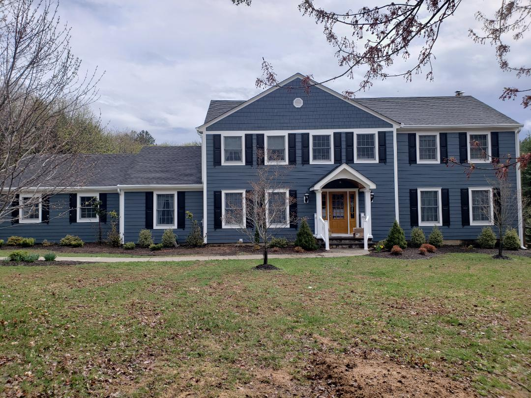 Mendham, NJ - All Done with Our James Hardie Siding Project with Shutters, New Gutters,New Front Door, New Front Overhang. Color of Siding: Evening Blue #carpenterstouch #jameshardieelitepreferred #jameshardiesiding #jameshardie #siding #hardielockdown #hardienation #GodisGood