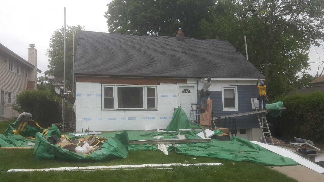 Cedar Grove, NJ - We are here at our clients house in Cedar Grove replacing their siding with CertainTeed monogram and Cedar impressions. Also we are placing their fascia board which was rotted.
