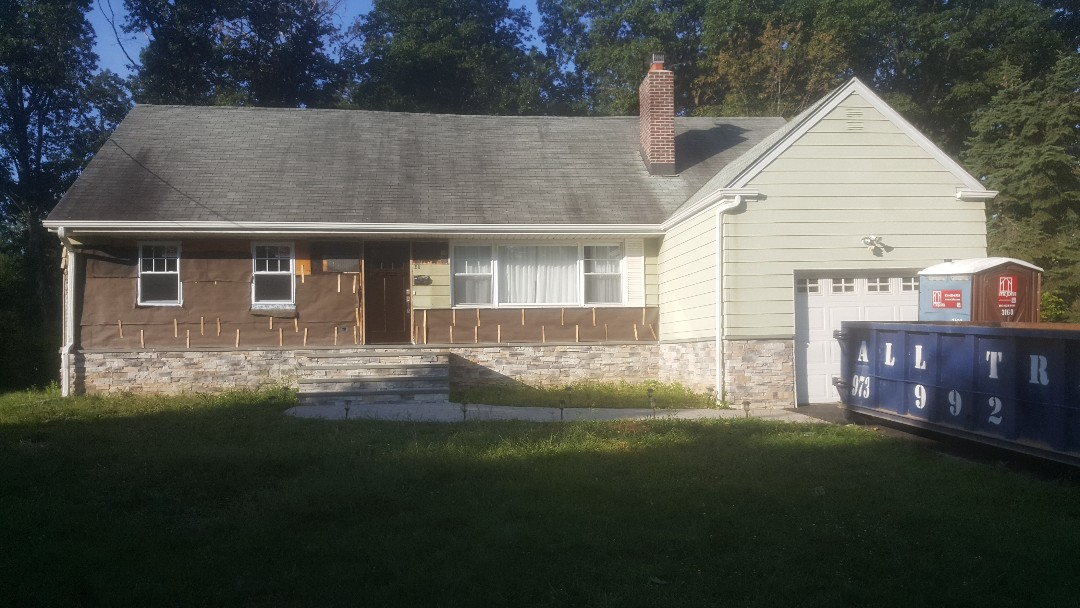 West Caldwell, NJ - This is the before picture of our new James Hardie deep ocean smooth job here in West Caldwell, New Jersey; more to follow as we move along.