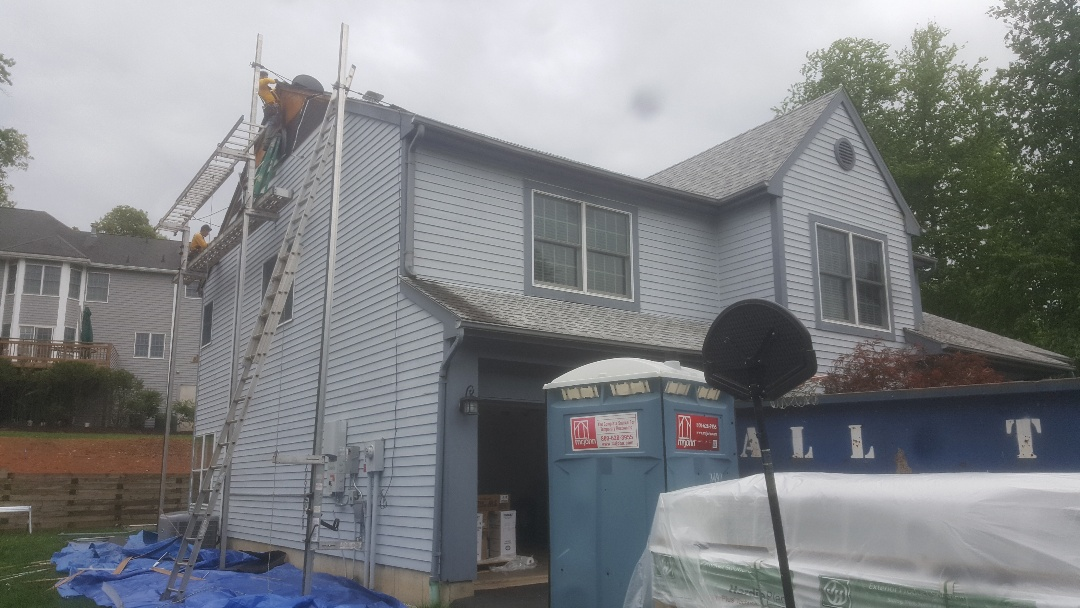 New Providence, NJ - New James Hardie project in Berkeley Heights: 5in lap siding color: gray slate. Get a free estimate today!
