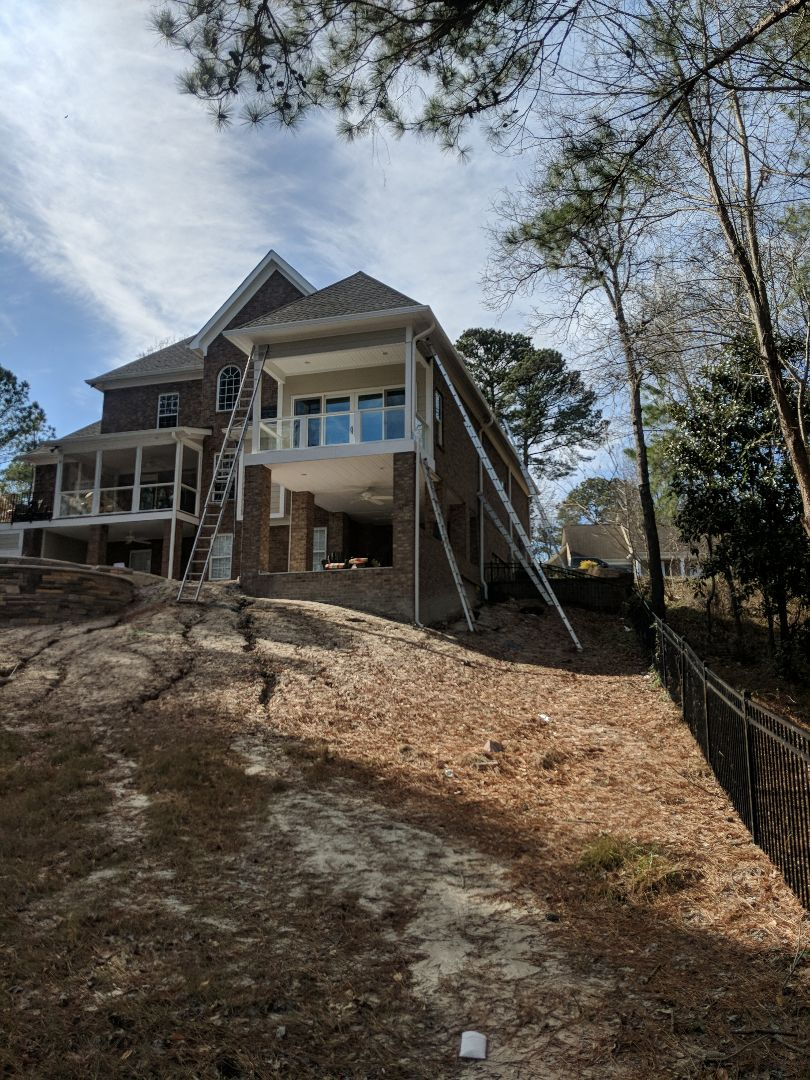 Columbia, SC - I guess we took a few ladders out to hang this seamless gutter and downspout, 40' and 32' ladders!