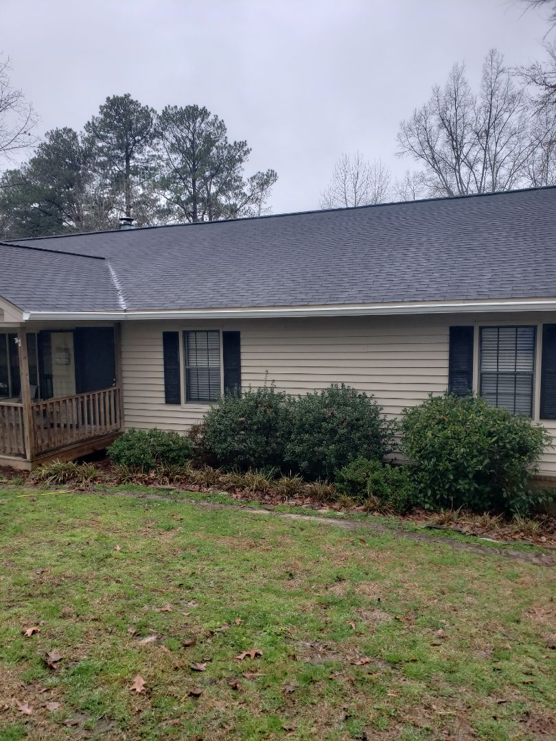 Ridgeway, SC - Gutter and downspout in the rain for house closing