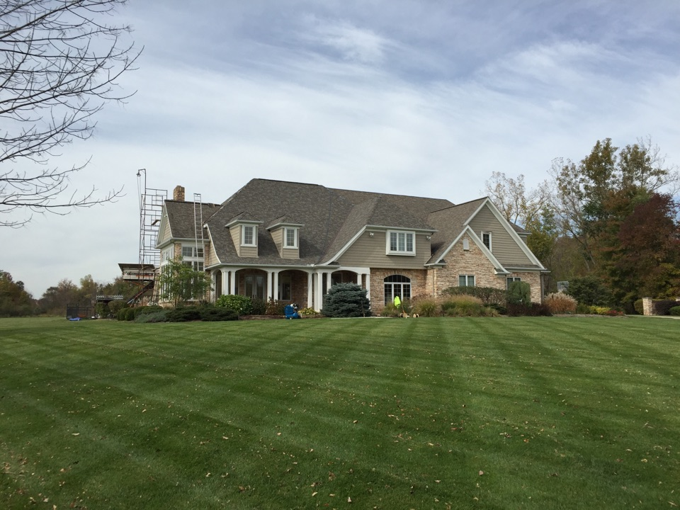 Chagrin Falls, OH - Tearinf off a roof on a home that sustained storm damaged recently and installing Certainteed Independence shangles - Weathered Wood.