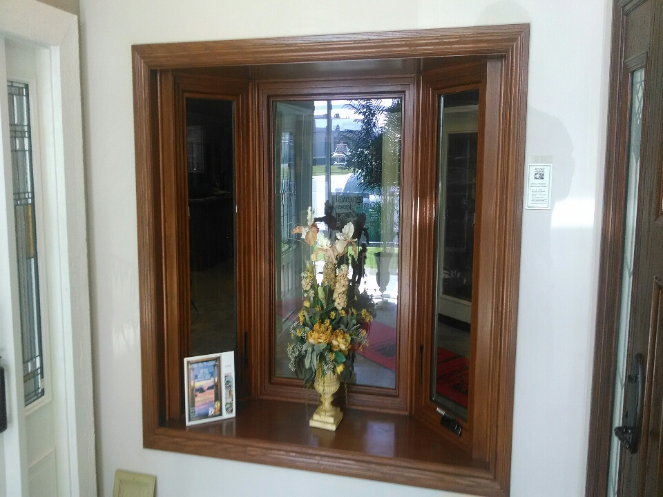 Laguna Hills, CA - Renewal by Andersen bay window in showroom with oak interior using side casements.