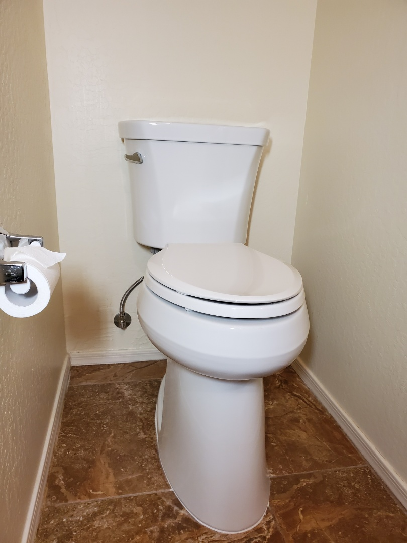 Waddell, AZ - Replace toilet with tall Kohler i. Waddell